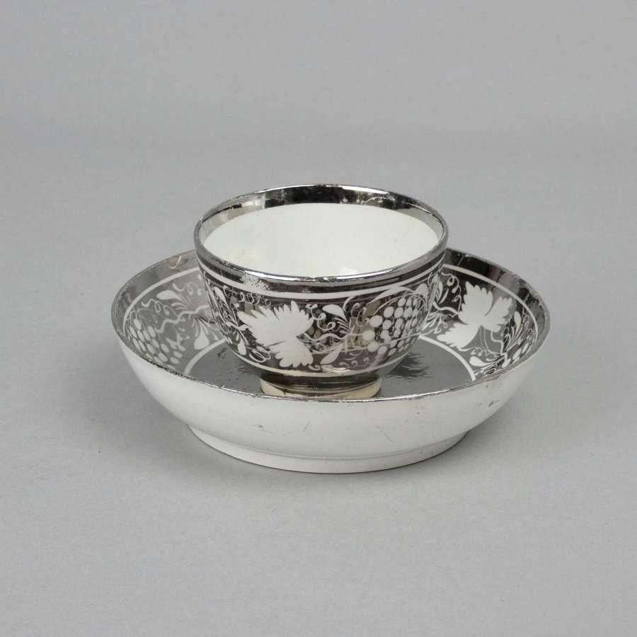 Silver lustre tea bowl & saucer