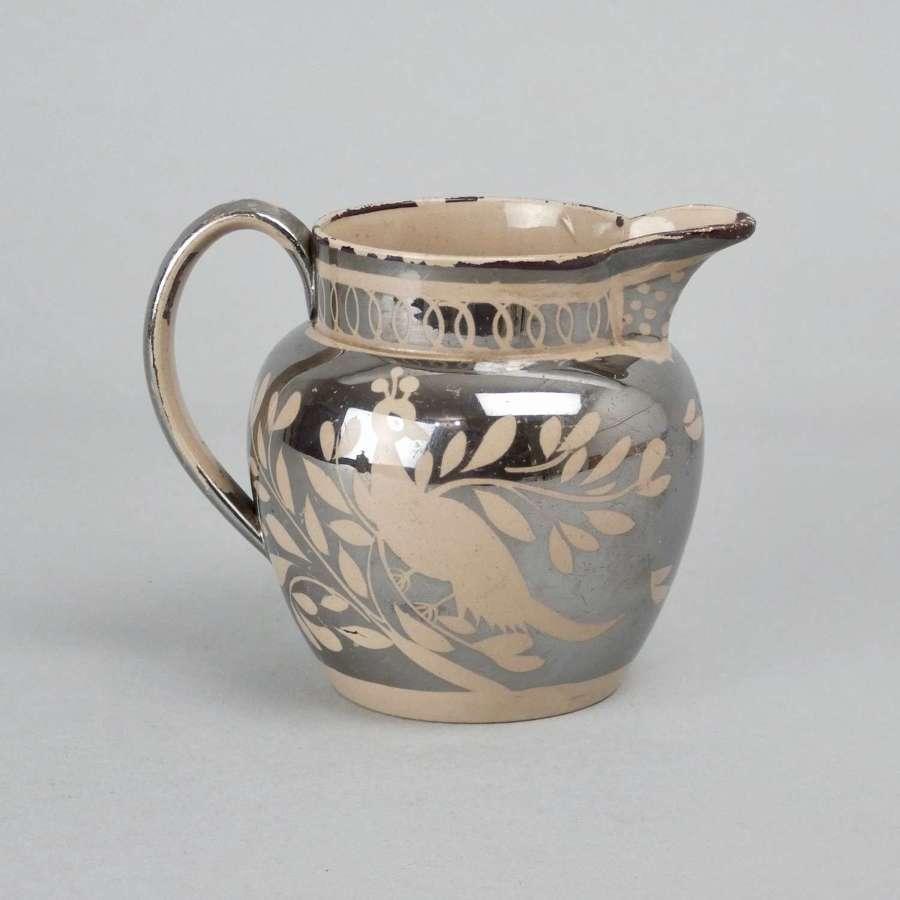Small, silver lustre jug