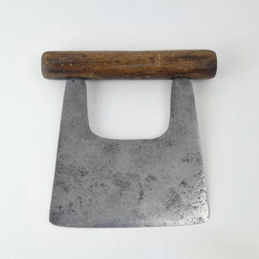Primitive, steel cheese cutter